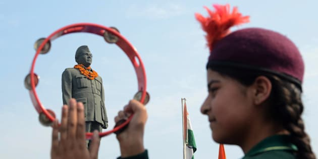 An Indian school band performs near the statue of  freedom fighter, Netaji Subhash Chandra Bose in Amritsar on January 23, 2013, as part of celebrations for his 116th birth anniversary. Bose was a prominent Indian nationalist leader who attempted to gain India's independence from British rule by force during the waning years of World War II.  AFP PHOTO/NARINDER NANU        (Photo credit should read NARINDER NANU/AFP/Getty Images)
