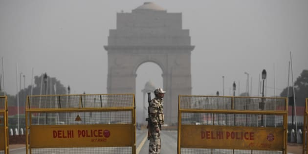 An Indian paramilitary soldier stands guard near a police barricade in front of India Gate, the landmark war memorial on Rajpath, the ceremonial boulevard for Republic Day parade in New Delhi, India, Thursday, Jan. 21, 2016. Security has been beefed up across India ahead of the Republic Day celebrations on Jan. 26, when French President Francois Hollande will be the chief guest. (AP Photo/Altaf Qadri)