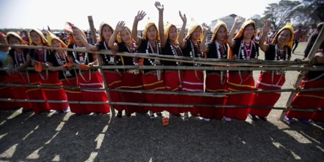 Adi tribal women from Arunachal Pradesh in their traditional attire wave to India's main opposition Bharatiya Janata Party (BJP)'s prime ministerial candidate Narendra Modi at a public rally in Pasighat, in east Siang district of Arunachal Pradesh state, India, Saturday, Feb. 22, 2014. The general elections are scheduled to be held later this year. (AP Photo/Anupam Nath)