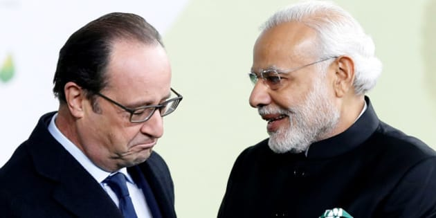 French President Francois Hollande, left, greets India's Prime Minister Narendra Modi as he arrives for the COP21, United Nations Climate Change Conference, in Le Bourget, outside Paris, Monday, Nov. 30, 2015. (Guillaume Horcajuelo, Pool via AP)