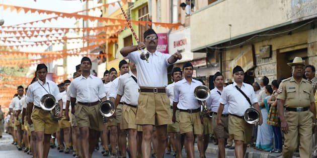 The band of Rashtriya Swayamsevak Sangh (RSS) take part in the 'Shrung Ghosh Path Sanchalan' (Route March by Brass Band) by RSS cadets in Bangalore on January 9, 2016.  The march was part of Rashtriya Swayamsevak Sangh's Akhil Bharatiya Shrung Ghosh (Brass Band) four-day Shibir 'Swaranjalj.'  AFP PHOTO/ Manjunath KIRAN / AFP / Manjunath Kiran        (Photo credit should read MANJUNATH KIRAN/AFP/Getty Images)
