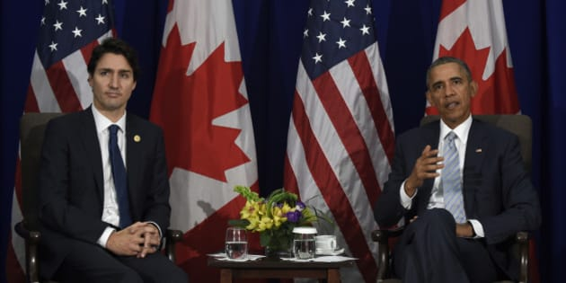 President Barack Obama, right, and Canada's Prime Minister Justin Trudeau, left, speak to reporters following their bilateral meeting at the Asia-Pacific Economic Cooperation summit in Manila, Philippines, Thursday, Nov. 19, 2015. (AP Photo/Susan Walsh)