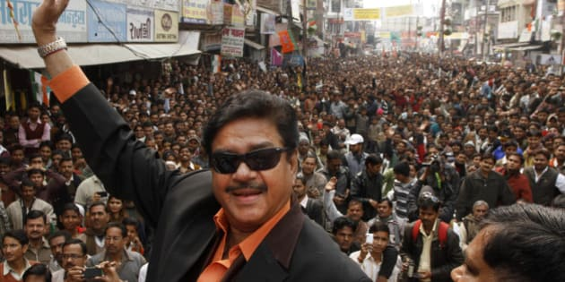Bharatiya Janata Party leader and Bollywood actor Shatrughan Sinha, waves to the crowd as he attends an election campaign rally in Allahabad, India, Monday, Feb. 13, 2012. India's largest state Uttar Pradesh is currently going to the polls in seven-phases in a month long local election with repercussions for the whole nation. (AP Photo/Rajesh Kumar Singh)