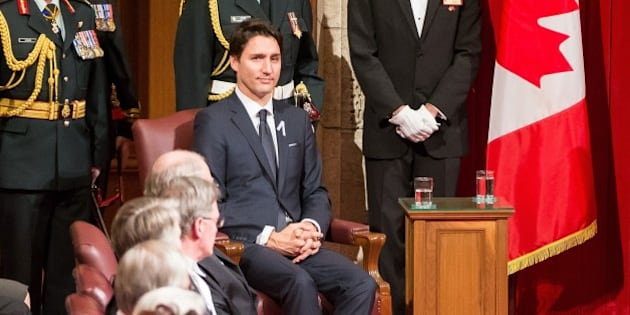 Prime Minister Justin Trudeau listens as Governor General David Johnston delivers the Speech from the Throne to the start Canada's 42nd parliament Ottawa, Canada on December 4, 2015.   AFP PHOTO/GEOFF ROBINS / AFP / GEOFF ROBINS        (Photo credit should read GEOFF ROBINS/AFP/Getty Images)