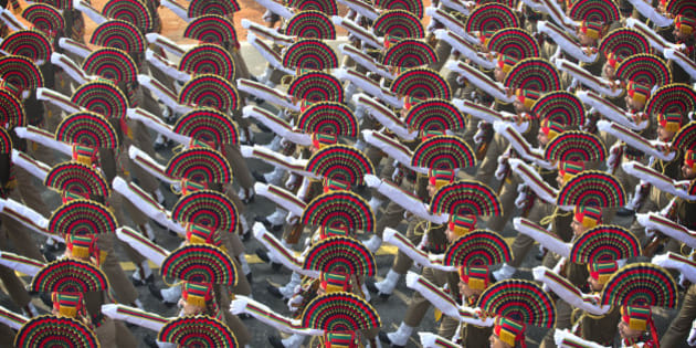FILE - In this Saturday, Jan. 23, 2016, file photo, Indian paramilitary force soldiers march during the full dress rehearsal of the Republic Day parade, in New Delhi, India. India celebrates Republic Day on Jan. 26 every year with a march by different branches of the military as well as a display of arms and missiles. (AP Photo/Manish Swarup, File)