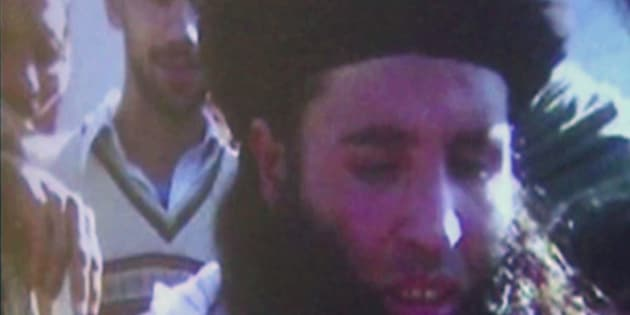 In this image made from video broadcast on Thursday, Nov. 7, 2013, undated footage of Mullah Fazlullah is shown on a projector in Pakistan. Fazlullah, the ruthless commander behind the attack on teenage activist Malala Yousafzai as well as a series of bombings and beheadings, was chosen Thursday as the leader of the Pakistani Taliban, nearly a week after a U.S. drone strike killed the previous chief. (AP Photo via AP Video)