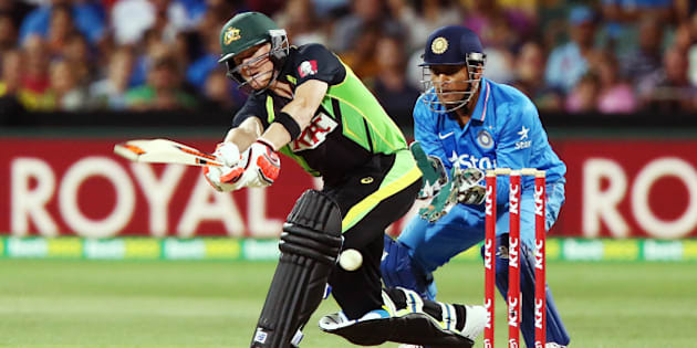 ADELAIDE, AUSTRALIA - JANUARY 26: Steve Smith of Australia bats in front of MS Dhoni of India during game one of the Twenty20 International match between Australia and India at Adelaide Oval on January 26, 2016 in Adelaide, Australia.  (Photo by Morne DeKlerk - CA/Cricket Australia/Getty Images)