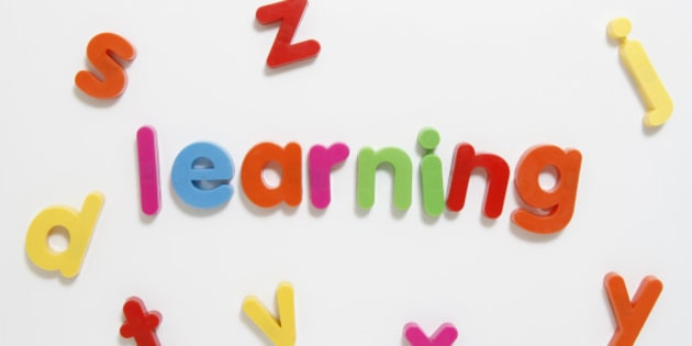 Alphabet fridge magnets spelling 'learning'