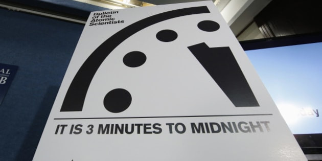 A sign showing the 'Doomsday Clock' that remains at three minutes to midnight is seen after it was unveiled by the Bulletin of the Atomic Scientists, Tuesday, Jan. 26, 2016, during a news conference at the National Press Club in Washington. The clock was last moved January 2015, from five minutes to three minutes before midnight, the closest it has been to catastrophe since the days of hydrogen bomb testing. (AP Photo/Alex Brandon)