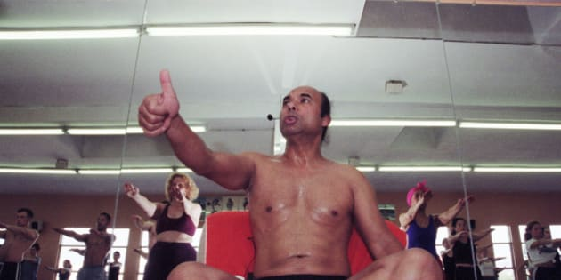 Low-angle view of Indian Yoga guru Bikram Choudhury as he instructs his yoga class in heated room, Beverly Hills, California, February 2, 2000. (Photo by Bob Riha, Jr./Getty Images)