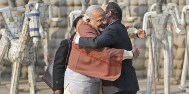 Indian Prime Minister Narendra Modi, left and French President Francois Hollande greet each other at the Rock Garden in Chandigarh, India, Sunday, Jan. 24, 2016. Hollande began a three-day visit to India on Sunday that could push a multibillion-dollar deal for combat airplanes and closer cooperation on counterterrorism and clean energy. (AP Photo/Manish Swarup)