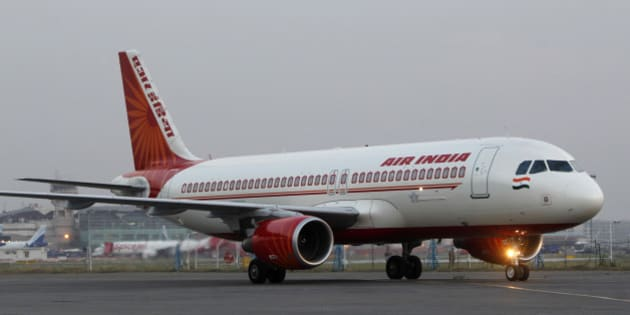 An Air India plane taxies at the Indira Gandhi International airport in New Delhi, India in New Delhi, India, Friday, May 11, 2012. Hundreds of passengers have been stranded in India after Air India canceled around 20 international flights due to a strike by pilots. (AP Photo/ Mustafa Quraishi)