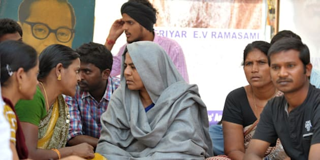 Radhika Vemula, the mother of a student who committed suicide on January 17, sits during a protest at Hyderabad Central University in Hyderabad on January 21, 2016. Rohit Vemula, a 26-year-old doctoral student at the university of Hyderabad, was found on January 17, triggering protests in the southern city and New Delhi. He was one of five students, all from India's lowest Dalit social caste, to be suspended by the university after they were accused of assaulting the head of a right-wing student political group -- a charge they denied. AFP PHOTO / Noah SEELAM / AFP / NOAH SEELAM        (Photo credit should read NOAH SEELAM/AFP/Getty Images)