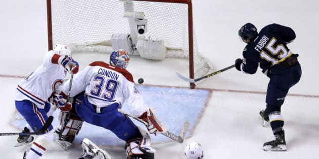 St. Louis Blues' Robby Fabbri, right, scores past Montreal Canadiens goalie Mike Condon (39) and Alexei Emelin, left, of Russia, during the first period of an NHL hockey game Saturday, Jan. 16, 2016, in St. Louis. (AP Photo/Jeff Roberson)