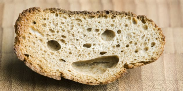 Piece of whole wheat bread with smiley face
