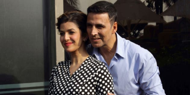 Indian Bollywood actors Akshay Kumar (R) and Nimrat Kaur pose during the media interaction of their upcoming Hindi film 'Airlift' directed by Raja Krishna Menon in Mumbai on January 15, 2016.   AFP PHOTO / AFP / STR        (Photo credit should read STR/AFP/Getty Images)