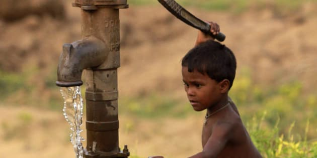 A young Indian boy pumps water from a tube well and stretches to fill a bottle with water, on the outskirts of Bhubaneshwar, India, Saturday, May 12, 2012. According to U.N. estimates, more than one in six people worldwide do not have access to 20-50 liters (5-13 gallons) of safe freshwater a day to ensure their basic needs for drinking, cooking and cleaning. (AP Photo/Biswaranjan Rout)