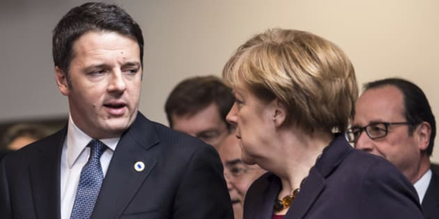 German Chancellor Angela Merkel, second right, speaks with Italian Prime Minister Matteo Renzi, left, during a group photo at an EU summit in Brussels on Thursday, Dec. 18, 2014. European Union leaders meet with the top agenda item an ambitious plan to use EU seed money and loan guarantees to jumpstart investment and revive the EU's anemic growth and job creation rates. (AP Photo/Geert Vanden Wijngaert)