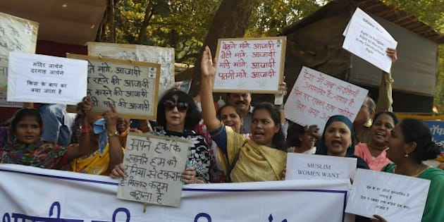 Indian activists take part in a protest against a ban on women entering its inner sanctum of the Haji Ali mosque, in Mumbai on January 28, 2016. A landmark mosque in Mumbai is facing pressure to overturn a ban on women entering its inner sanctum, a move that could set a precedent on gender restrictions to places of worship in the deeply religious country. A Muslim women's rights group is locked in a bitter legal battle with trustees of Mumbai's Haji Ali Dargah, built in the 15th century and popular not only with Muslims but Hindu devotees and sight-seeing tourists.  AFP PHOTO / PUNIT PARANJPE / AFP / PUNIT PARANJPE        (Photo credit should read PUNIT PARANJPE/AFP/Getty Images)