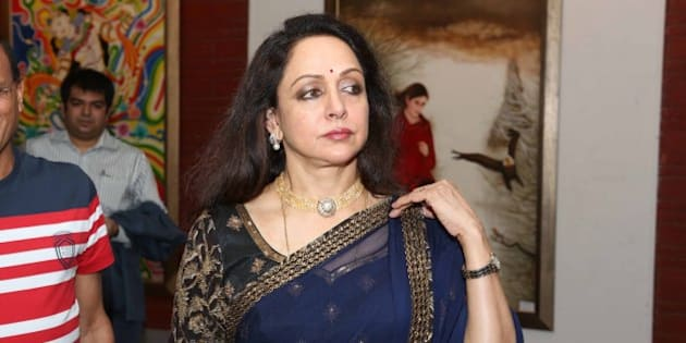NEW DELHI, INDIA - JUNE 28: Bollywood actor Hema Malini at the Exhibition Ganpati & Chromophore  by Artists Seema Chaudhary and Nitin Chaudhary at Open Palm Court Gallery, IHC on June 28, 2013 in New Delhi, India. (Photo by Prabas Roy/Hindustan Times via Getty Images)