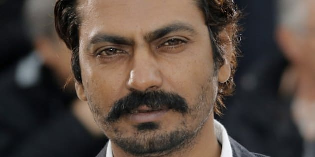 Actor Nawazuddin Siddiqui poses for photographers during a photo call for the film Monsoon Shootout at the 66th international film festival, in Cannes, southern France, Saturday, May 18, 2013. (AP Photo/Francois Mori)