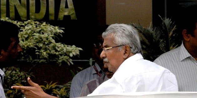 NEW DELHI, INDIA - JUNE 27: Kerala Chief Minister Oommen Chandy arrives for participating in the 4th meeting of CM`s sub group of Niti Aayog at Niti Aayog on June 27, 2015 in New Delhi, India. The sub-group was constituted by the Prime Minister in March this year in pursuance of decision taken in the first meeting of governing council of NITI Ayog a month earlier. (Photo By Sonu Mehta/Hindustan Times via Getty Images)