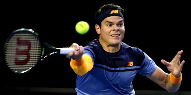 Milos Raonic of Canada plays a forehand return to Andy Murray of Britain during their semifinal match at the Australian Open tennis championships in Melbourne, Australia, Friday, Jan. 29, 2016.(AP Photo/Rick Rycroft)