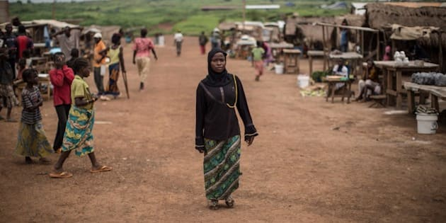 A Muslim refugee form Central African Republic, walks along a street at the Mole refugee camp, 35 Kms south of Zongo, at the Equator region, on June 20, 2015, as nations mark World Refugee Day. About 17000 Central African Republic (CAR) refugees live in this area, located near Bangui, after fleeing brutal inter-religious violence in 2013-2014. The United Nations this week reported that 60 million people -- half of them children -- have been forced to flee conflict and persecution. AFP PHOTO/FEDERICO SCOPPA        (Photo credit should read FEDERICO SCOPPA/AFP/Getty Images)