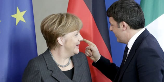 German Chancellor Angela Merkel, left, and Prime Minister of Italy Matteo Renzi, right, talk after a joint press conference as part of a meeting at the chancellery in Berlin, Germany, Friday, Jan. 29, 2016. (AP Photo/Michael Sohn)