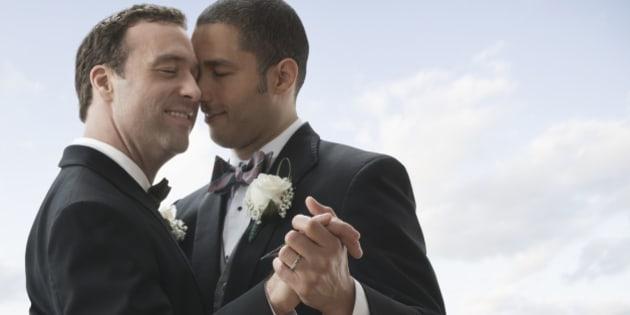 Newlywed grooms dancing