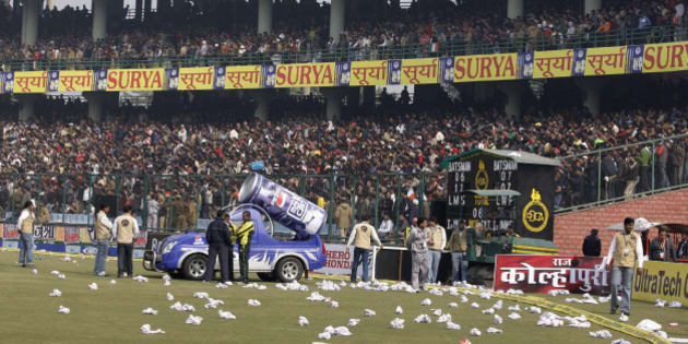 Rolled seat covers are seen lying on the ground after spectators threw them in protest after the fifth and final one-day international cricket match between India and Sri Lanka was abandoned at the Feroz Shah Kotla stadium in New Delhi, India, Sunday, Dec. 27, 2009. A dangerous pitch caused the match  to be abandoned. (AP Photo/Aijaz Rahi)