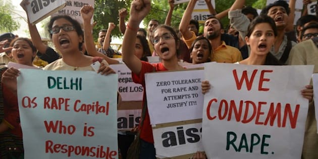 NEW DELHI, INDIA OCTOBER 16: Members of AISA and JNUSU holding  Plycards during a Protest against the latest Incident of Rape.against Delhi Police at PHQ  in New Delhi.(Photo by K.Asif/India Today Group/Getty Images)