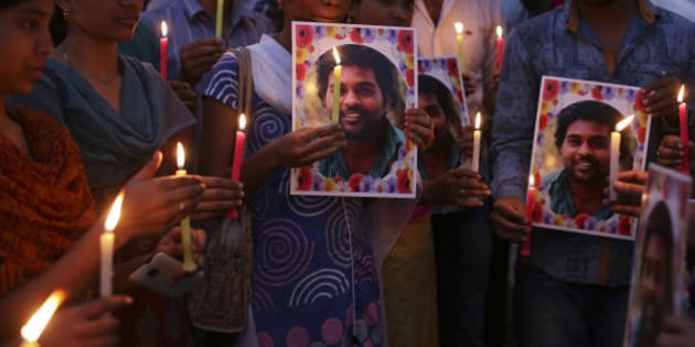 Activist of a Dalit organization participate in a candle light vigil holding photographs of Indian student Rohith Vemula in Hyderabad, India, Wednesday, Jan 20, 2016. The activists were protesting the death of Vemula who, along with four others, was barred from using some facilities at his university in the southern tech-hub of Hyderabad. The protesters accused Hyderabad University's vice chancellor and a federal minister of unfairly demanding punishment for the five lower-caste students after they clashed last year with a group of students supporting the governing Hindu nationalist party. (AP Photo/Mahesh Kumar A.)
