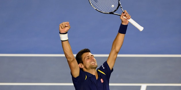 Novak Djokovic of Serbia celebrates his victory over Andy Murray of Britain in their men's singles final match on day 14 of the 2016 Australian Open tennis tournament in Melbourne on January 31, 2016.     AFP PHOTO / GREG WOOD