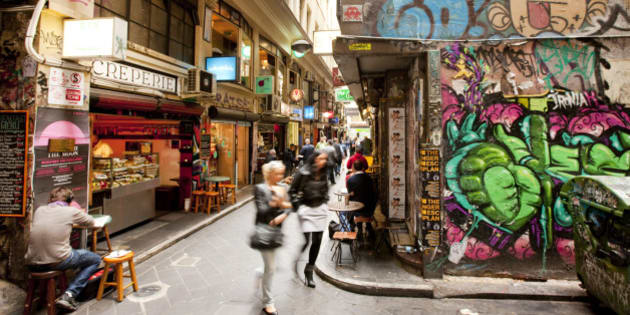 Busy city laneways, with cafes and graffitti, Melbourne, Victoria, Australia