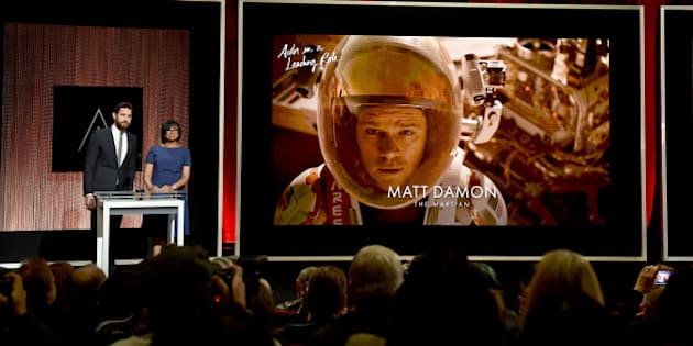 LOS ANGELES, CA - JANUARY 14:  Actor John Krasinski and President of the Academy of Motion Picture Arts and Sciences Cheryl Boone Isaacs announce Matt Damon as a nominee for Best Actor in a Leading Role in the film 'The Martian' during the 88th Oscars Nominations Announcement at the Academy of Motion Picture Arts and Sciences on January 14, 2016 in Los Angeles, California.  (Photo by Kevin Winter/Getty Images)