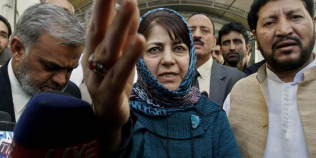 Leader of the opposition Mehbooba Mufti speaks to reporters outside the state legislature house in Srinagar, India, Wednesday, Sept. 28, 2011. The legislature in Indian-controlled Kashmir erupted in chaos Wednesday and was adjourned for the day over a clemency request for a man sentenced to death in a deadly 2001 attack on India's Parliament. (AP Photo/Mukhtar Khan)