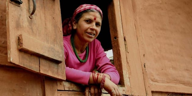 """A curious local woman looking out from her window.  (By Pravin Tamang)  <a href=""""http://www.traveltodarjeeling.com"""" rel=""""nofollow"""">www.traveltodarjeeling.com</a>"""