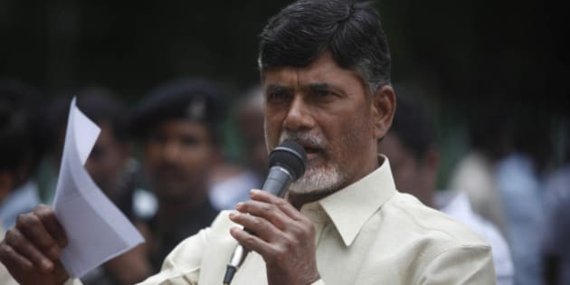 Telugu Desam Party (TDP) President N. Chandrababu Naidu speaks during a protest against the Babli Dam project in front of a statue of Mahatma Gandhi in Hyderabad, India, Wednesday, July 21, 2010. The protestors alleged that Maharashtra state is building the dam across River Godavari illegally and this would deprive Andhra Pradesh state of its due share of Godavari waters. Naidu was earlier arrested while trying to visit the project site and was forced to return to Hyderabad on Tuesday. (AP Photo/Mahesh Kumar A.)