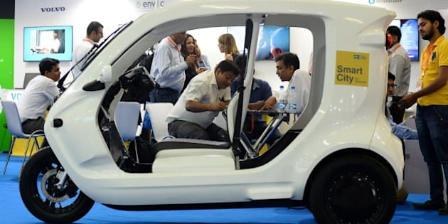 A Swedish Newly Zbee electric car is displayed at the Smartcity Expo in the Indian capital New Delhi on May 20, 2015. The Zbee is an energy-efficient electric vehicle designed to carry goods or a small number of passengers short distances. AFP PHOTO / SAJJAD HUSSAIN        (Photo credit should read SAJJAD HUSSAIN/AFP/Getty Images)