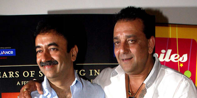 Indian Bollywood film actor and cast member of Hindi film 'Lage Raho Munna Bhai', Sanjay Dutt (R) and film director Rajkumar Hirani attend producer-director Vidhu Vinod Chopra's 'A Film Festival' in Mumbai late March 31, 2012.  AFP PHOTO/STR (Photo credit should read STRDEL/AFP/Getty Images)