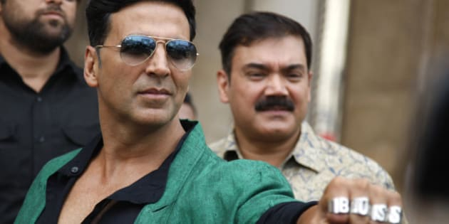 """Bollywood actor Akshay Kumar shows his rings during a promotional event of his upcoming movie """"Boss"""" in Hyderabad, India, Friday, Oct. 11, 2013. The film will be released across the country on October 16. (AP Photo/Mahesh Kumar A.)"""