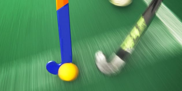 Hockey tackle with a yellow ball touchline