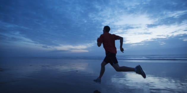 USA, Oregon, Rockaway Beach, Man running along beach