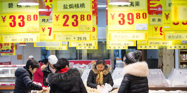 HANGZHOU, CHINA - JANUARY 19:  (CHINA OUT) Citizens purchase goods at a supermarket on January 19, 2016 in Hangzhou, Zhejiang Province of China. China's GDP in 2015 was about 67.67 trillion yuan (10.29 trillion USD), grew by 6.9 percent which became the lowest growth rate during the last 25 years.  (Photo by ChinaFotoPress/ChinaFotoPress via Getty Images)