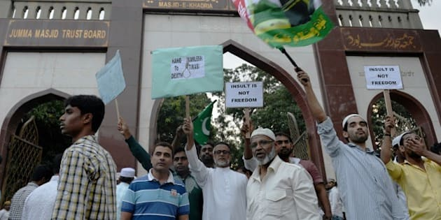 Indian Muslims protest against alleged statements made by Kamlesh Tiwari, working president of the Hindu Mahasabha of Uttar Pradesh, said to have been defamatory against the Prophet Mohammad, in front of the Masjid-E-Khadria mosque prior to Friday evening prayers in Bangalore on December 11, 2015. AFP PHOTO/Manjunath KIRAN / AFP / MANJUNATH KIRAN        (Photo credit should read MANJUNATH KIRAN/AFP/Getty Images)