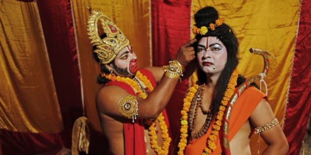 In this Sunday, Sept. 28, 2014 photo, Indian artists prepare themselves before going on stage for a traditional Ramleela drama, narrating the life of Hindu God Rama, to celebrate the festival of Dussehra in Allahabad, India. The Hindu festival of Dussehra commemorates the triumph of Lord Rama over the demon king Ravana, marking the victory of good over evil. (AP Photo/Rajesh Kumar Singh)