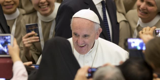 Pope Francis arrives for an audience with nuns and priests, in the Pope Paul VI hall at the Vatican, Monday, Feb. 1, 2016. (AP Photo/Andrew Medichini)