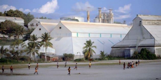 NAURU - JANUARY 01:  Men play Australian rules football in Nauru, South Pacific  (Photo by Tim Graham/Getty Images)