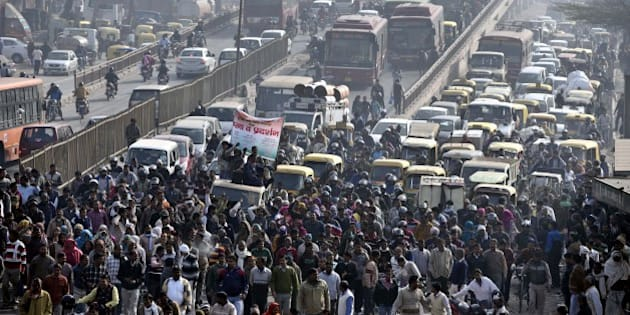 NEW DELHI, INDIA - FEBRUARY 2: Heavy traffic jam after MCD workers protest at Gokulpuri Chowk against the government for non-payment of their salaries, on February 2, 2016 in New Delhi, India. Around 150, 000 municipal corporation employees including sanitation workers, teachers and doctors are on strike over non-payment of salaries for the past three months. (Photo by Arun Sharma/Hindustan Times via Getty Images)